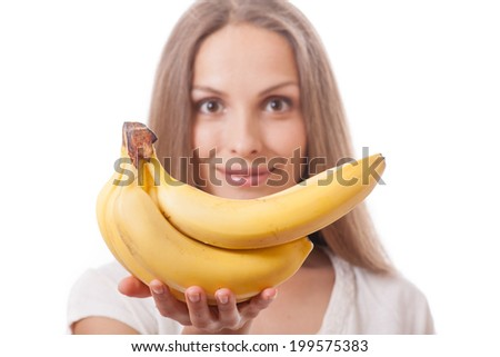 young girl holding yellow banana - stock photo