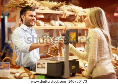 Young girl in a bakery - stock photo