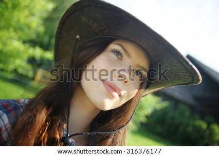 young girl in a cowboy hat - stock photo