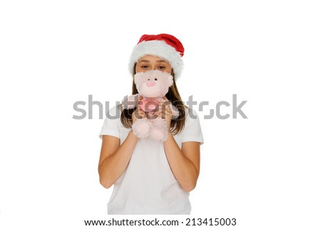 Young girl in a festive red Santa hat with a fluffy pink teddy bear held up in front of her face, isolated on white - stock photo
