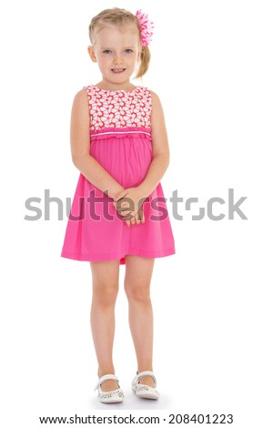 young girl in a pink dress on a white background.kindergarten, the concept of childhood and joy, teens - stock photo