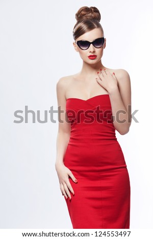 Young girl in a red dress on a white background - stock photo
