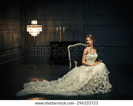 Young girl in a white dress - stock photo