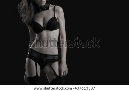 Young girl in black underwear. Isolated on black. - stock photo