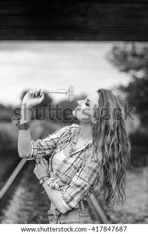 Young girl in blue shorts on the railway station - stock photo
