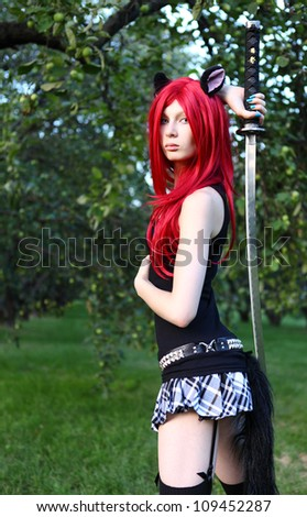 young girl in cat manga wear holding sword at the summer park - stock photo
