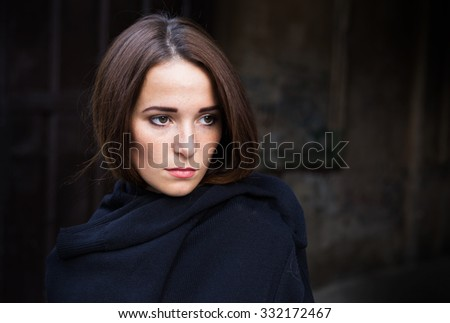 young Girl in depression on dark background - stock photo