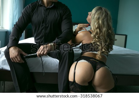 young girl in erotic lingerie with a man - stock photo