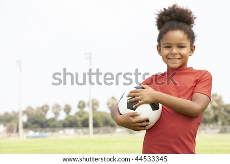 Young Girl In Football Team - stock photo