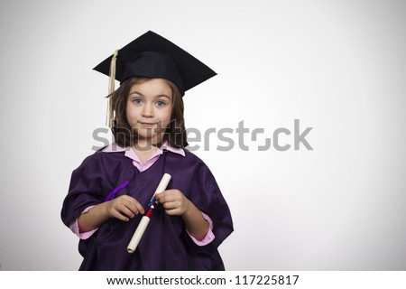 Young girl in graduation dress  with diploma over white background - stock photo