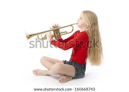 young girl in red playing trumpet against white background - stock photo