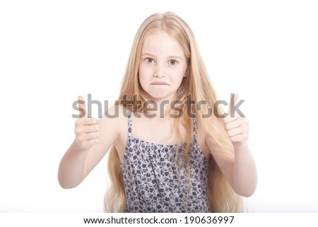 young girl in studio with both thumbs up against white background - stock photo