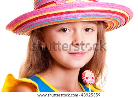 Young girl in summer straw hat with a lilipop - stock photo