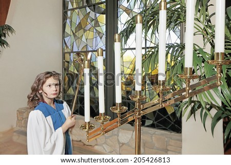 Young girl in the church - stock photo