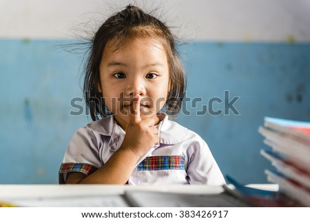 Young girl in the shool. Thai school in a small village - stock photo