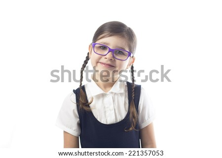Young girl in uniform ready for her first day of school. - stock photo