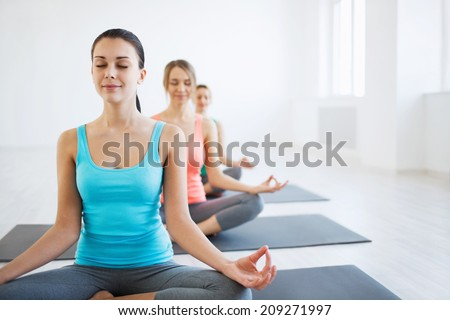 Young girl in yoga classes - stock photo