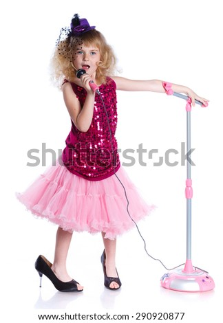 Young girl is singing with a microphone. Isolated on white background. - stock photo