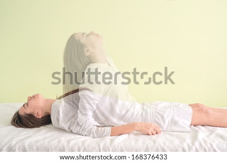 Young girl is waking up again.    When the soul leaves the body. - stock photo