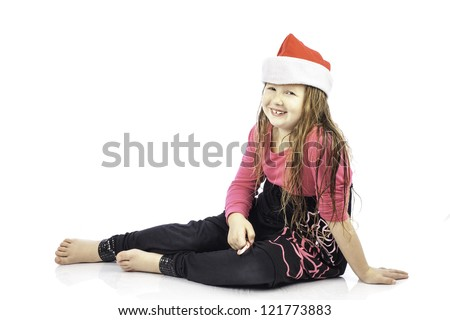 Young girl isolated on white wearing a santa hat - stock photo
