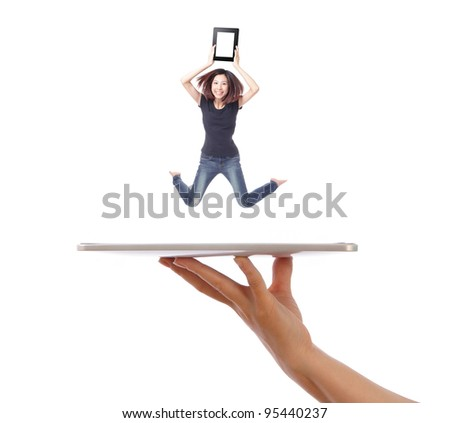 Young girl jump and showing tablet pc on people hand isolated on white background, model is a asian beauty - stock photo