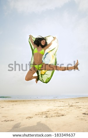 young girl jumping for for joy with Brazil flag  - stock photo
