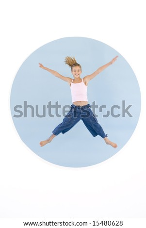Young girl jumping with arms out smiling - stock photo