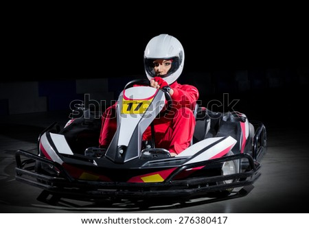 Young girl karting driver isolated - stock photo