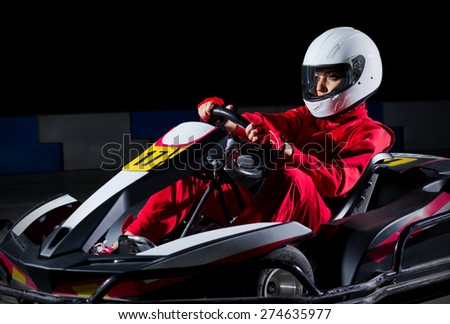 Young girl karting racer isolated - stock photo