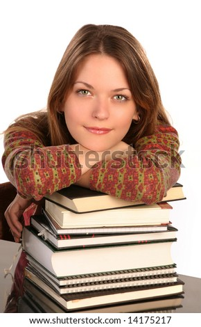 Young girl leaned over pile of books, isolated on white - stock photo