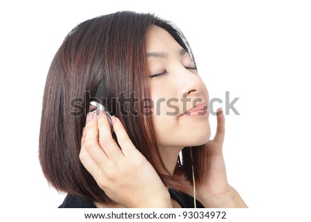Young girl listen music and close her eyes isolated on white background, model is a asian beauty - stock photo