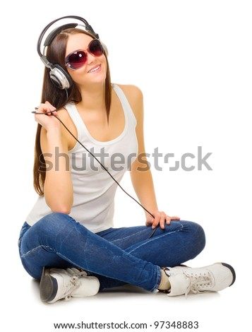 Young girl listen music isolated - stock photo