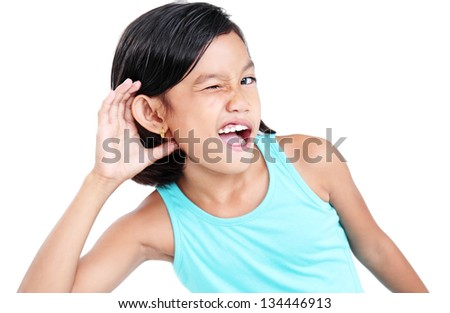Young girl listening to a sound.Isolated in white background. - stock photo