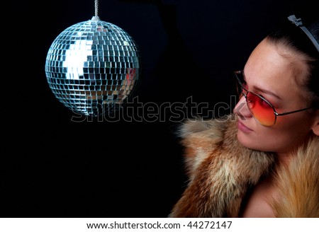 Young girl looking at disco sphere - stock photo