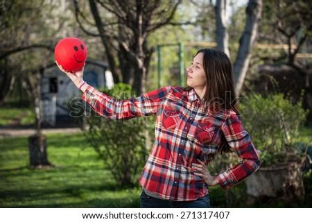 Young girl looking at the red balloon - stock photo