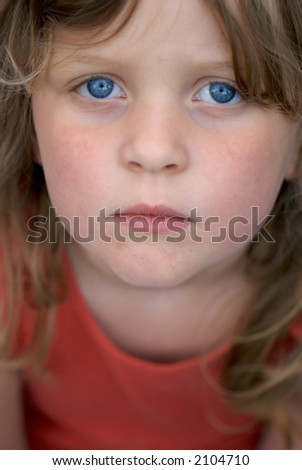 Young girl looking serious and upset - stock photo