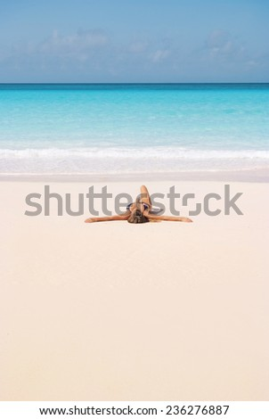 Young girl lying on the beach - stock photo