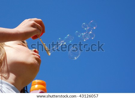 Young Girl makes Blow Bubbles - stock photo