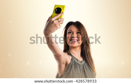 Young girl making a selfie - stock photo