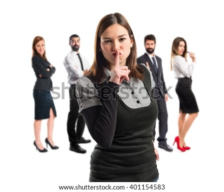 Young girl making silence gesture over isolated white background  - stock photo