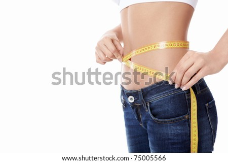 Young girl measuring waist on a white background - stock photo