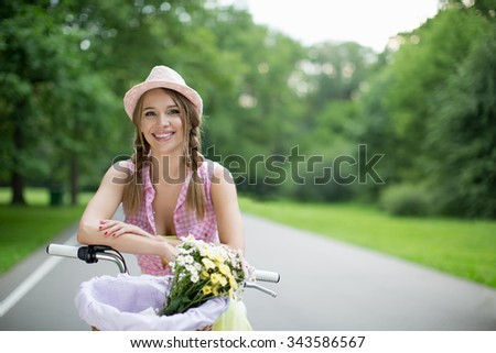 Young girl on a bicycle outdoors - stock photo