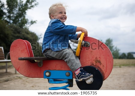 young girl on a seesaw - stock photo