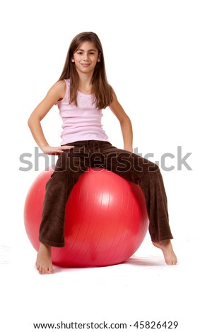 Young Girl On An Exercise Ball, Physically Fit - stock photo