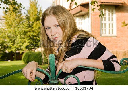 young girl on bench - stock photo