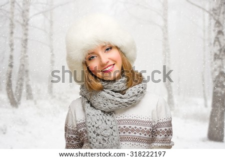 Young girl on snowy forest background - stock photo