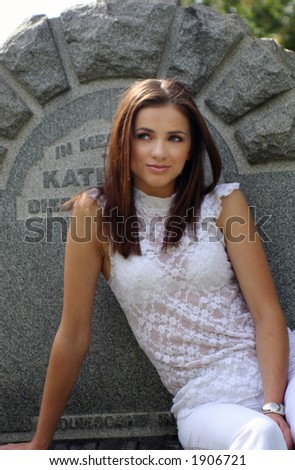 young girl on the cemetery - stock photo