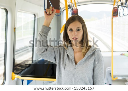 young girl on the public transport - stock photo