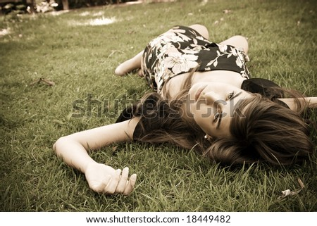 Young girl over the grass, vintage toned. - stock photo