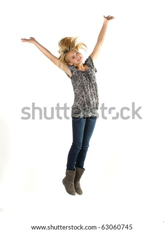 Young girl over white background in studio - stock photo